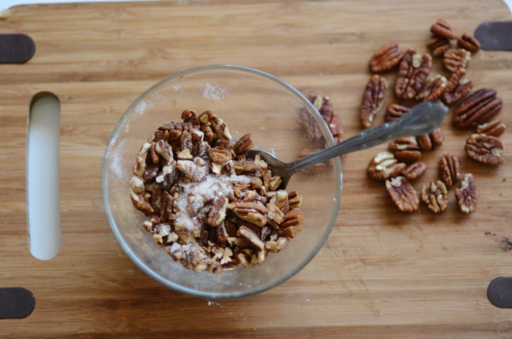 Adding the topping, the best part, cinnamon , sugar and pecans, yummy, yummy!